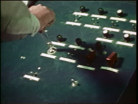 1960s close up man's hand turning key to shoot missiles on control panel / cold war / documentary - cold war stock videos and b-roll footage