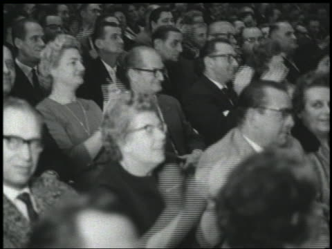 B/W 1960s close up seated audience clapping