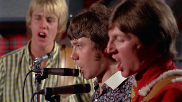 1960s close up three young men singing into microphones - performance group stock videos & royalty-free footage