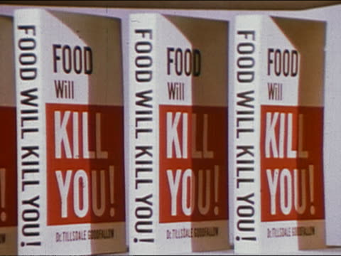 """1960s close up tilt up rows of books entitled """"Food Will Kill You!"""""""