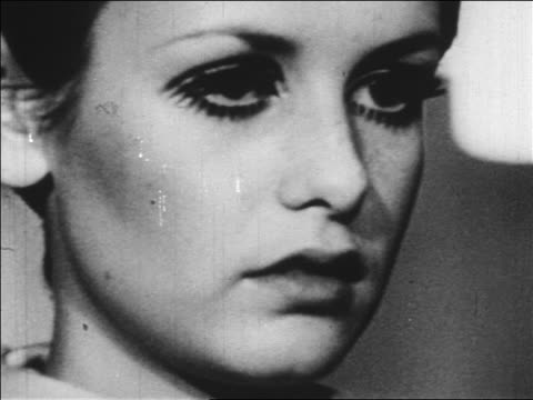 b/w 1960s close up twiggy's face smiling / newsreel - twiggy fashion model stock videos and b-roll footage