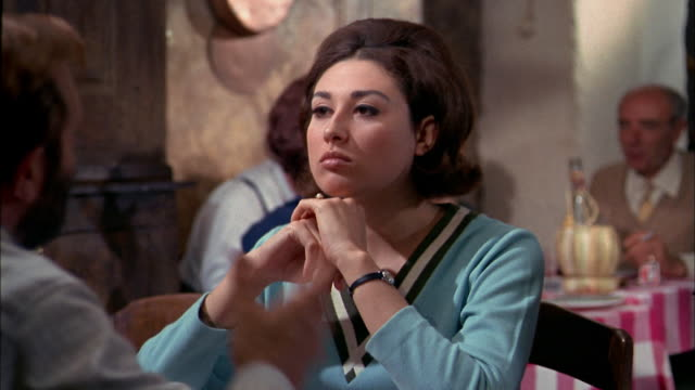 1960s close up woman arguing w/man at table in restaurant / Italy