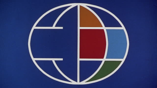 1960s close up zoom in multicolored animated globe / 'The Big Picture' logo / fade out