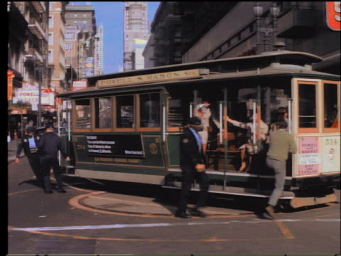 1960s PAN conductors rotate trolley turntable in San Francisco with passengers getting on + off