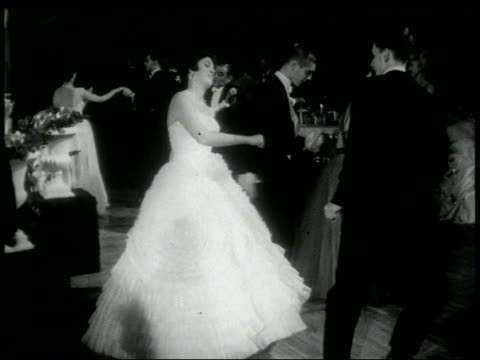 b/w 1960s couples in formalwear doing the twist at dance - klassischer rock and roll stock-videos und b-roll-filmmaterial