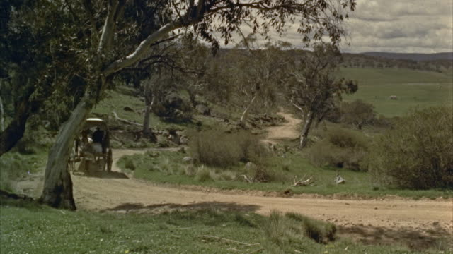 1960s ws covered wagon drawn by horse down country road - horse cart stock videos & royalty-free footage