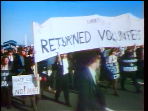 1960s crowd carrying returned volunteers signs banner marching in peace demonstration / newsreel - peace demonstration stock videos and b-roll footage
