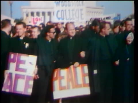 1960s crowd of priests carrying posters at peace demonstration / washington dc / newsreel - peace demonstration stock videos and b-roll footage