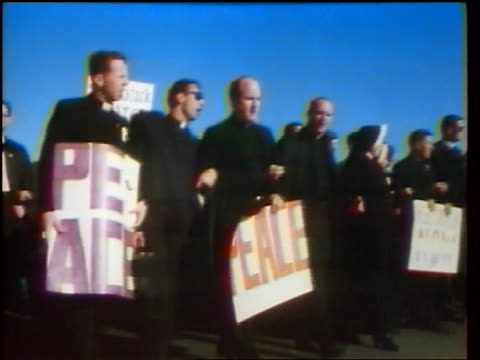 1960s crowd of priests others carrying posters marching in peace demonstration / washington dc - peace demonstration stock videos and b-roll footage