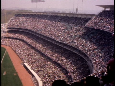 1960s ha ws crowd of spectators in dodger stadium / los angeles, california, usa - unknown gender stock videos & royalty-free footage