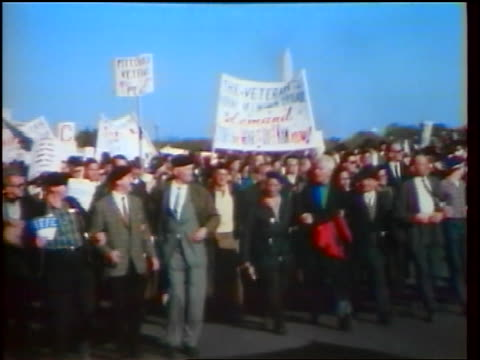 1960s crowd of veterans carrying signs marching in peace demonstration / washington dc / newsreel - peace demonstration stock videos and b-roll footage