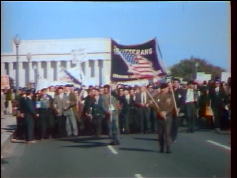 1960s crowd of veterans with banners american flag marching in demonstration / washington dc - peace demonstration stock videos and b-roll footage