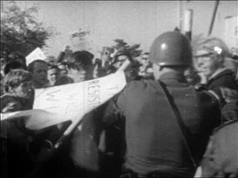 b/w 1960s crowd pushing toward national guard who start hitting them with clubs / newsreel - hippy stock videos & royalty-free footage