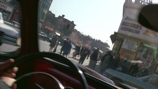 1960s ws pov driving along business street through heavy traffic - 1968 stock videos and b-roll footage
