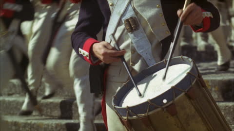 1960s cu drummer boy playing drum, armed palace guards in background - 1960 1969 stock videos & royalty-free footage