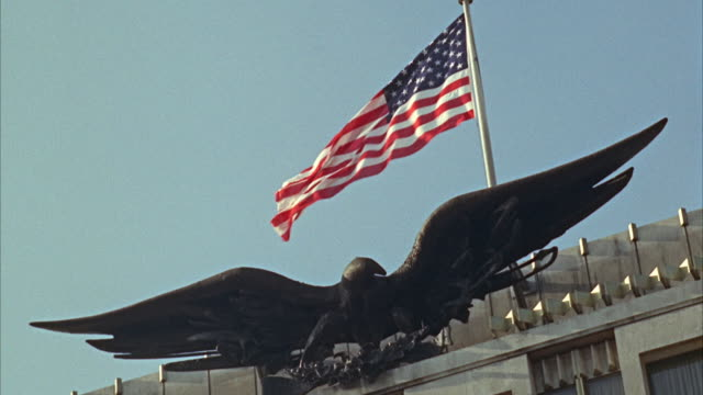 1960s ms la eagle and us flag atop embassy - us embassy stock videos & royalty-free footage