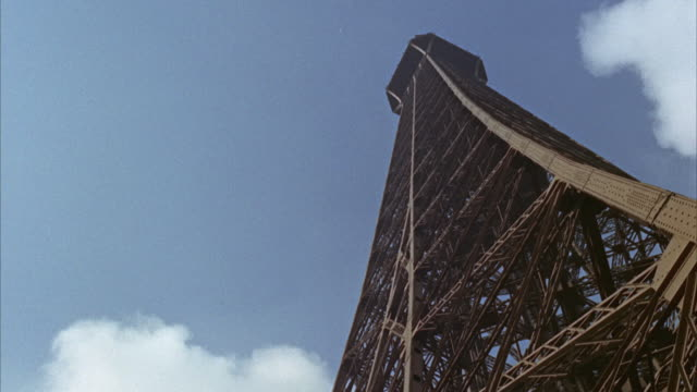 1960s ms la eiffel tower with clouds / paris, france - aufnahme von unten stock-videos und b-roll-filmmaterial