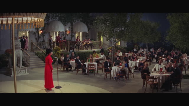 1960s ws elegant outdoor cafe with singer on stage - letterbox format stock videos & royalty-free footage