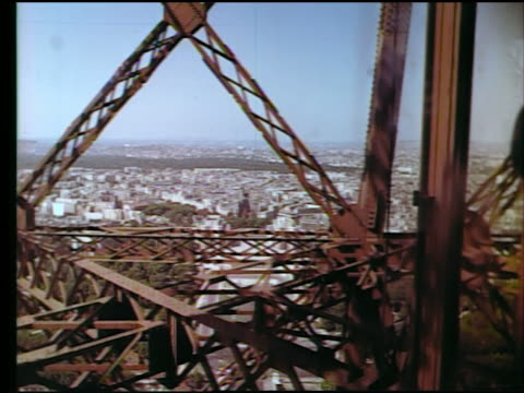 1960s elevator point of view from eiffel tower of cityscape + palais de chaillot / paris, france - inquadratura dall'ascensore video stock e b–roll