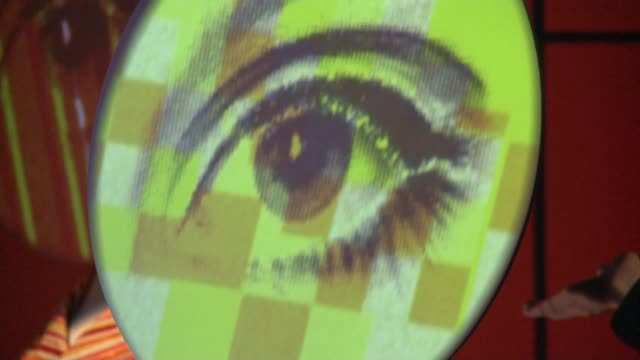 1960s exhibition at victoria and albert museum **music heard sot** projected eye display turning joe boyd ufo club posters - victoria and albert museum london stock videos & royalty-free footage