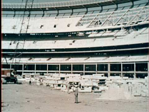 vídeos de stock, filmes e b-roll de 1960s film montage ws construction workers in unfinished shea stadium/ aerial stadium/ queens ny/ audio - flushing meadows corona park