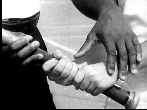 "vídeos de stock e filmes b-roll de ""1960s film montage cu man positioning boys hands on baseball bat/ ms boy assuming batting stance/ instructing/ ws boy hitting baseball/ st. louis, missouri"" - missouri"