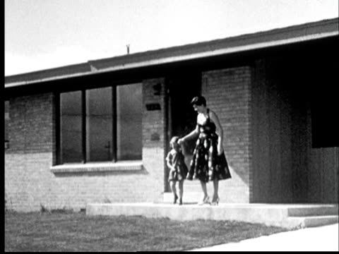 """""""1960s film montage ws mother, father, and three children walking out of suburban house together/ ms woman pointing/ broomfield, colorado"""" - home ownership stock videos & royalty-free footage"""