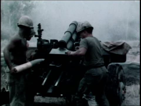 1960s first infantry division soldiers firing artiller / vietnam - infantry stock videos & royalty-free footage