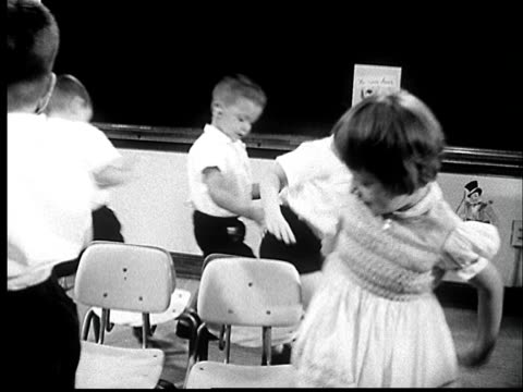 """""""1960s ms five children with hearing aids playing musical chairs/ ms one loses his seat and has to go sit down/ st. louis, missouri"""" - prelinger archive stock videos & royalty-free footage"""