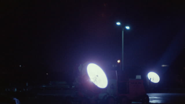1960s ms floodlight turning, hollywood, california, usa - flutlichter stock-videos und b-roll-filmmaterial