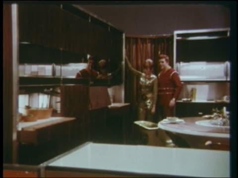 1960s futuristic couple watches as stoves + sink slide out from behind wall - 1960 stock videos and b-roll footage