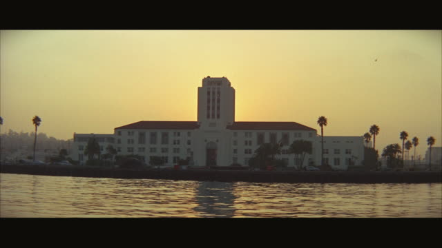 1960s WS POV Government building on waterfront / San Diego Bay, California, USA