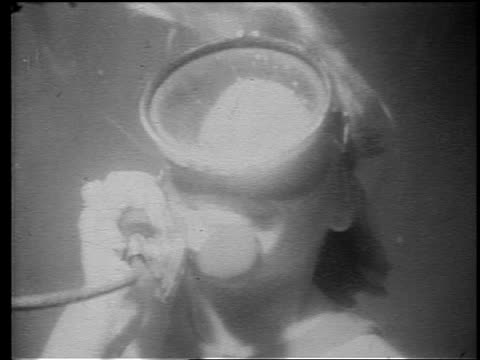 Bw 1960s Grainy Underwater Close Up Woman In Mask Talking On