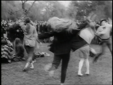 1960s group of hippies jumping + dancing in park / seattle / newsreel - hippy stock videos & royalty-free footage