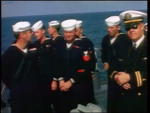 vídeos de stock, filmes e b-roll de 1960s group of sailors officer standing on deck of ship / newsreel - marinheiro