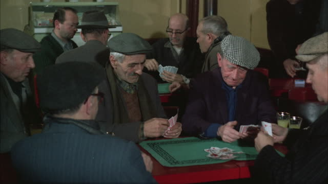 1960s ms group of senior men playing cards in club - playing card stock videos & royalty-free footage