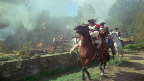 1960s ws group of soldiers on horses leaving burning farm buildings - 1960 1969 stock videos & royalty-free footage