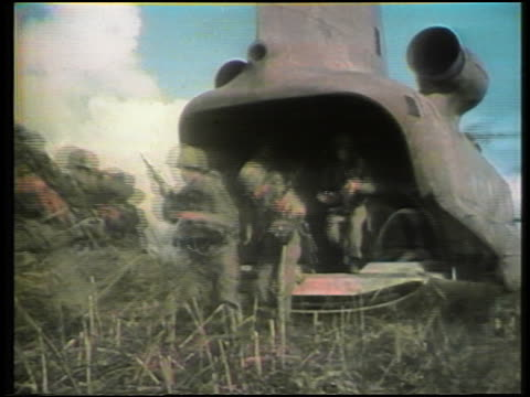 1960s group of us soldiers exiting back of helicopter during vietnam war - vietnamkrieg stock-videos und b-roll-filmmaterial