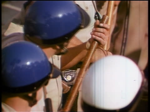 1960s high angle close up group of policemen in helmets holding nightsticks at demonstration - peace demonstration stock videos and b-roll footage