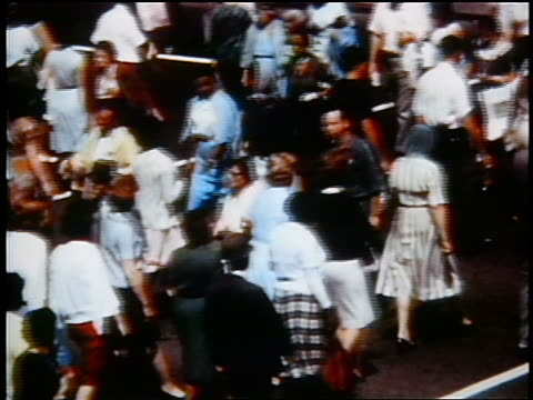 stockvideo's en b-roll-footage met 1960s high angle crowd crossing city street / detroit / industrial - prelinger archief