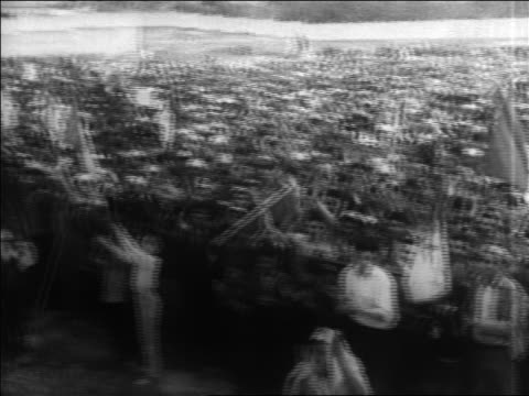 B/W 1960s high angle PAN crowd of Algerian nationalists cheering at rally / Algeria / educational