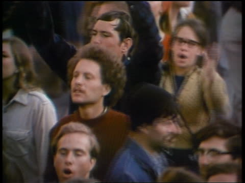 1960s high angle pan crowd of protesters shouting at peace demonstration - peace demonstration stock videos and b-roll footage