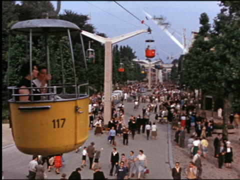 1960s high angle crowd with cable cars moving above at amusement park / Denmark