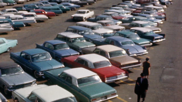 1960s high angle pan cars in large parking lot - londonalight stock videos and b-roll footage