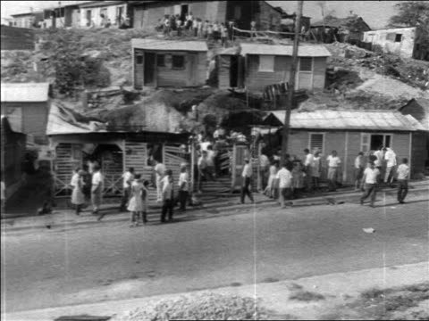1960s high angle people in front of shacks during revolution / dominican republic / newsreel - west indies stock videos & royalty-free footage
