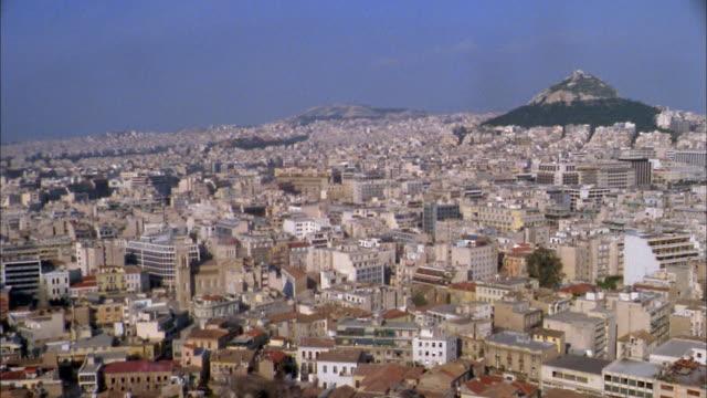 vidéos et rushes de 1960s high angle wide shot pan city skyline of athens, greece - athens greece
