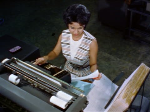 1960s high angle woman typing on teletypewriter in office / educational - secretary stock videos & royalty-free footage
