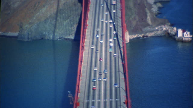 1960s high angle zoom out traffic on Golden Gate Bridge