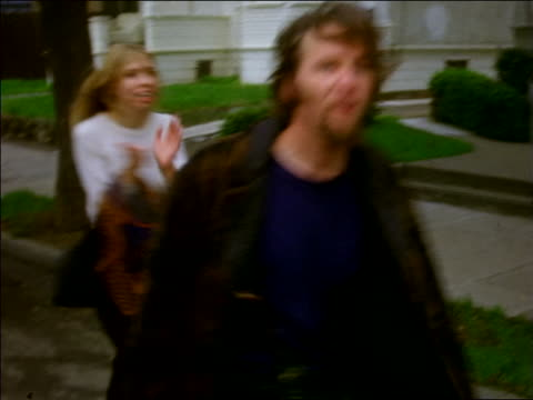 1960s pan hippies skipping clapping carrying banner in rent strike / berkeley ca - hippy video stock e b–roll