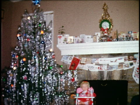 1960s home movie pan from fireplace with hanging stockings + cards to christmas tree in living room - 1960 stock videos and b-roll footage